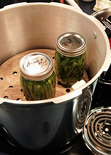 Jars being loaded into pressure canner | by Promoting Nutrition, Food Safety & Health