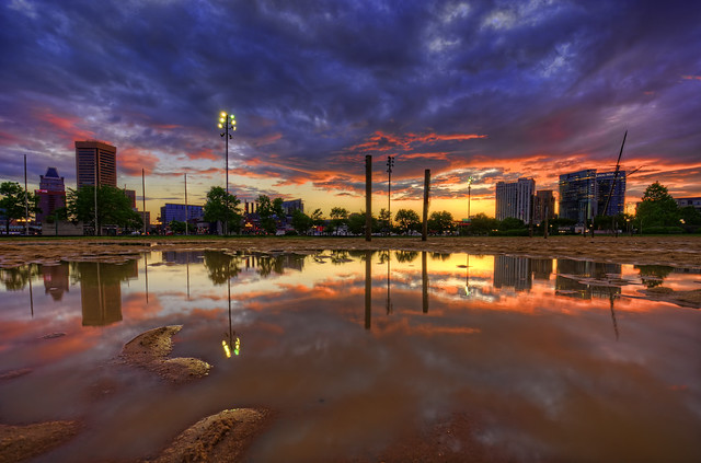 Baltimore: skyline puddle reflection sunrise