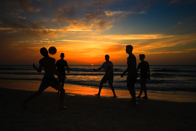 Playing on the beach at sunset - Tel-Aviv