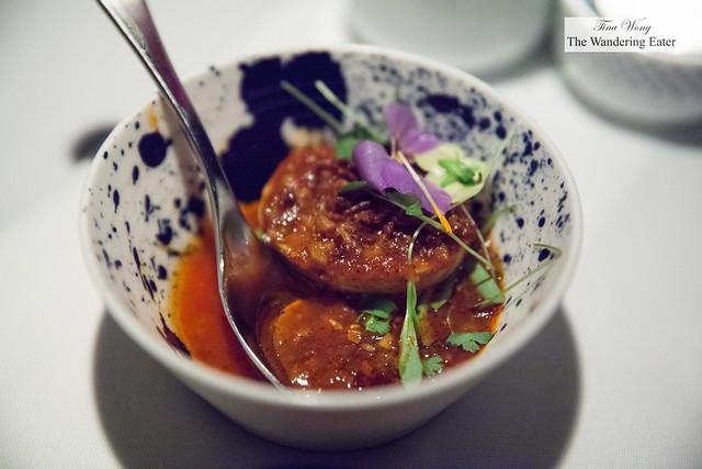 Hard boiled egg in tomato sambal sauce