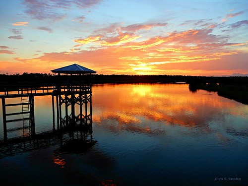 whyhewouldntbudge sprucecreekpark sunset creek nature outdoors sun settingsun reflections dock water sky clouds