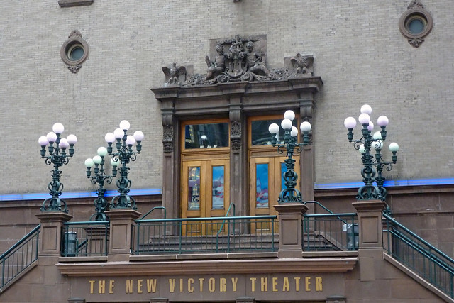 New Victory Theater at 42nd Street in the Theater District of Manhattan on a rainy day in New York City, NY