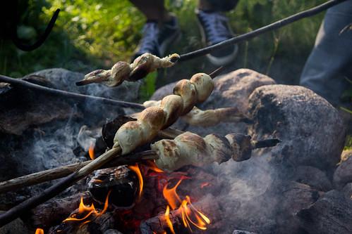 Kettukallion elämystila, stick buns over campfire | by visitsouthcoastfinland