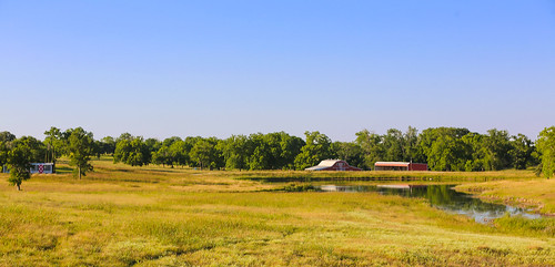 texas chappellhill farm barn outbuildings pond reflections pasture trees hills grass rural landscape wyojones np