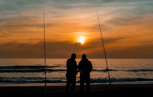 sanibel sunset fishermen walking waterways walkingaround lateafternoon outdoors urbanexploration colors beachscape beach seashore seascape beachshore sea