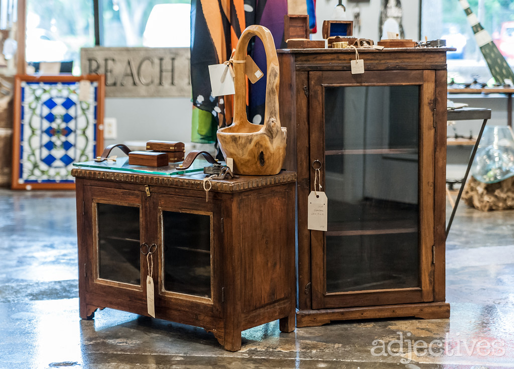 Wood and glass cabinets by Sprinkles Gifts at Adjectives Altamonte