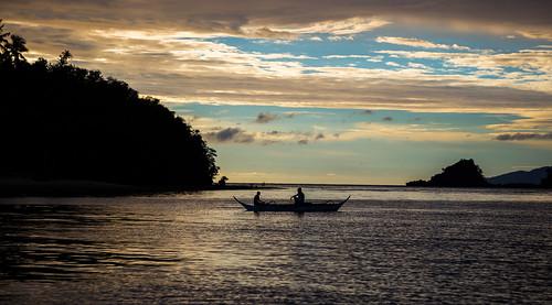 puertogalera philippines boat sun sunset sea ocean bay