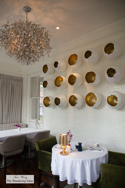 Dining area with a cool contemporary artwork on the wall