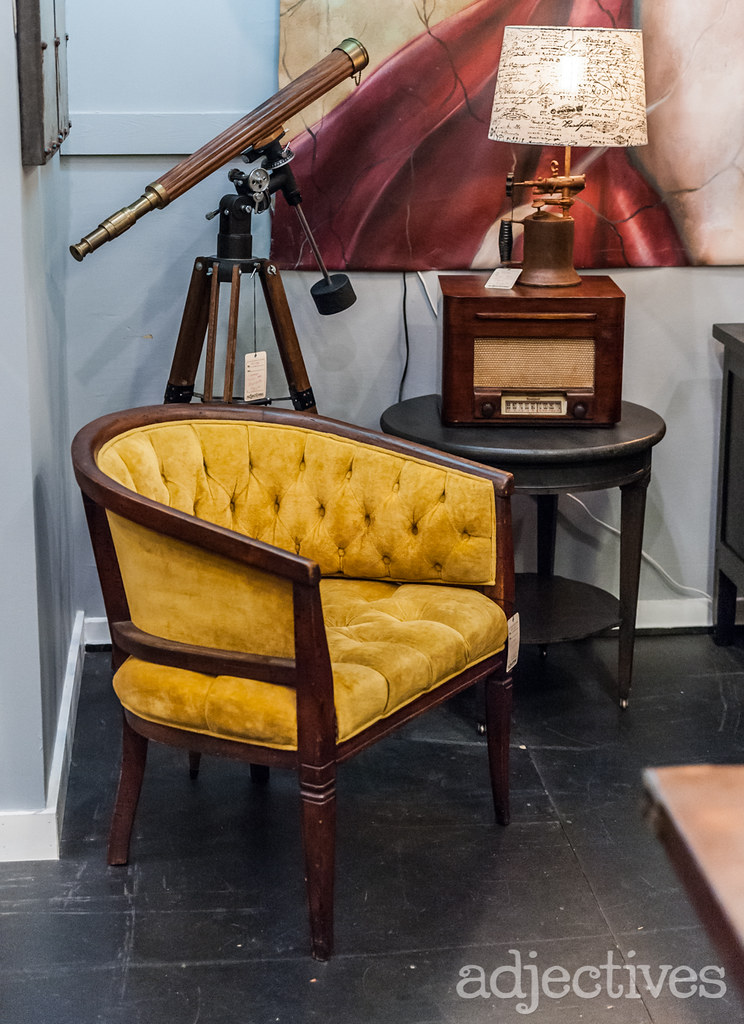Anitque Telescope, vintage chair, and vintage radio at Adjectives Winter Garden