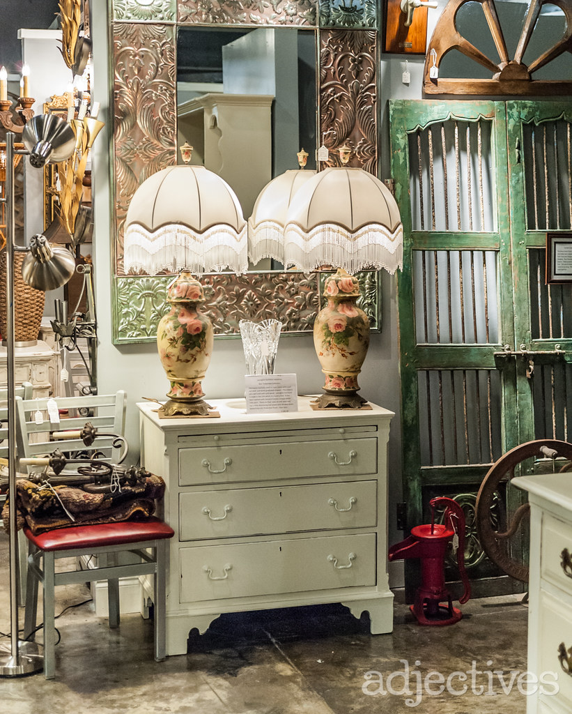 Antique lamps and vintage white dresser by Estate Antiques at Adjectives Altamonte