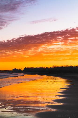 sunset beach sea water ocean silhouette goose rocks maine new england clouds sky orange pink yellow