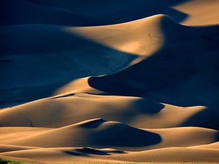 Hiker on Dune Ridges at Sunset | by Great Sand Dunes National Park and Preserve
