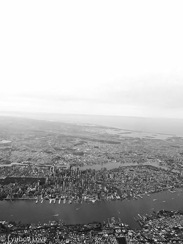 black white retro nyc new york city view views fly flying plane airplane planes buildings sky water skyscrapers skyline horizon