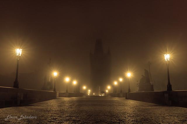 The Charles bridge at misty night