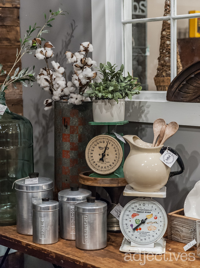 Vintage scale and tin containers at Adjectives Winter Garden