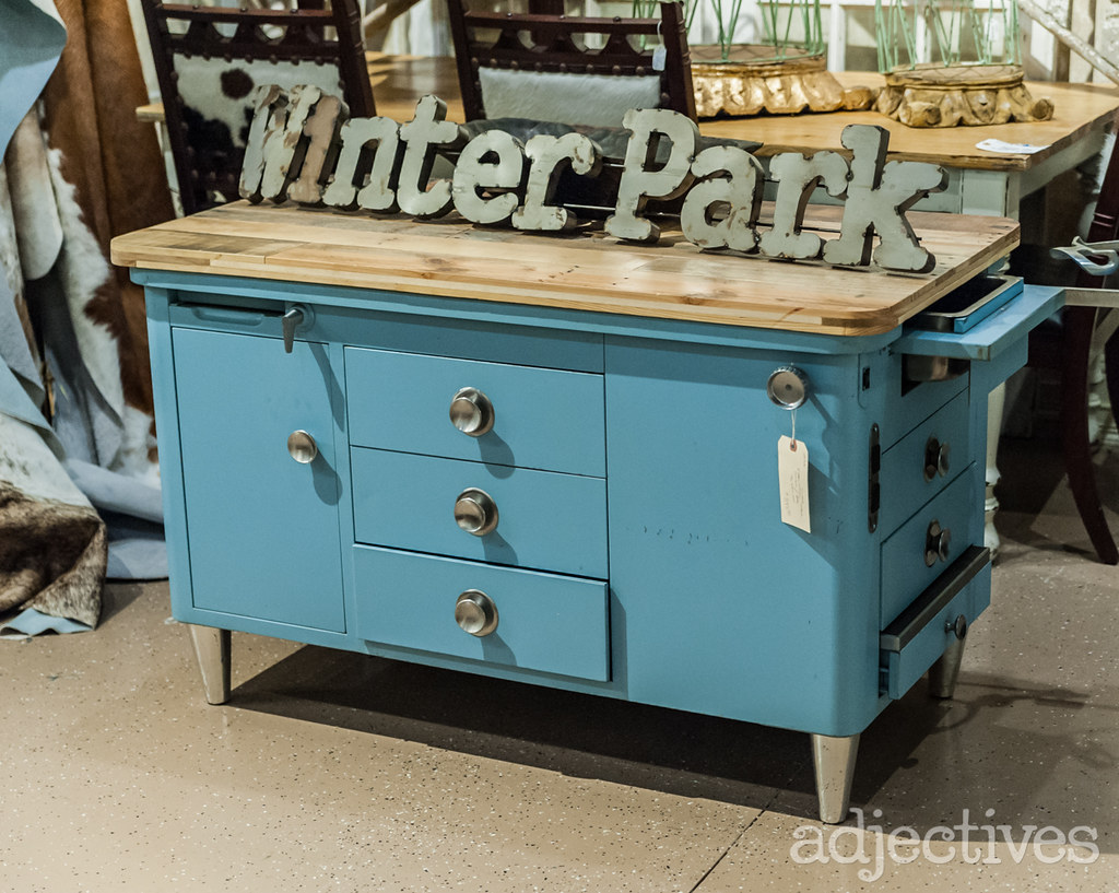 Industrial blue kitchen island with butcher block top by Uncle Mike at Adjectives Winter Park