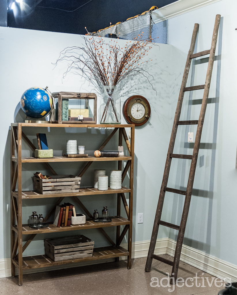 Rustic wood book shelf, home decor, and wood ladder at Adjectives Altamonte