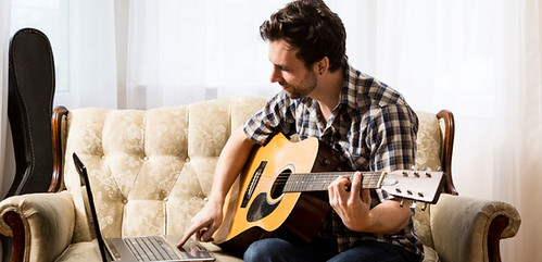 Man with Laptop and Guitar