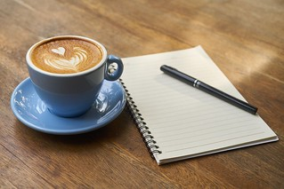 Coffee with Notebook on table in office | by Wallboat