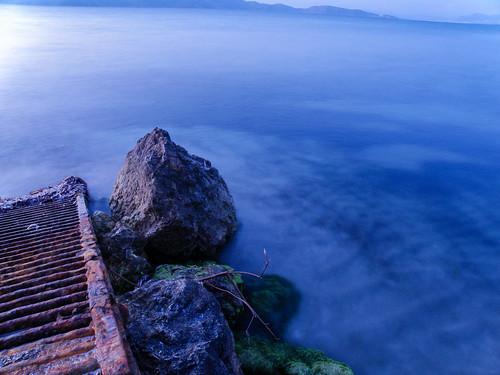 kos island sea seascape rocks sunset rusty waves long exposure water smooth