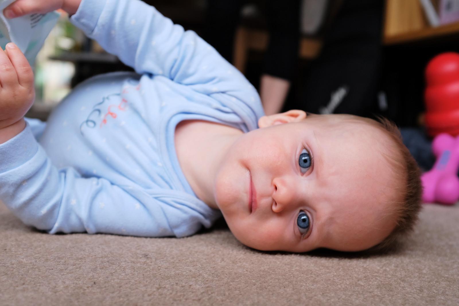 Baby boy lying on the floor