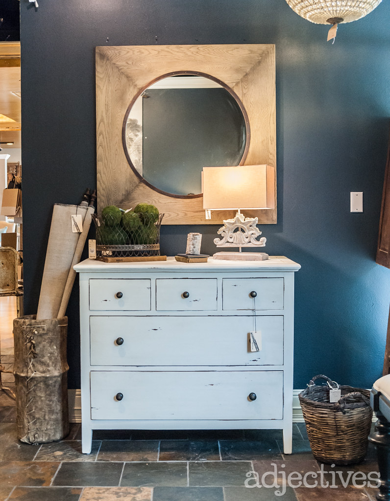 Rustic white wood dresser and bedroom decor at Adjectives Winter Park