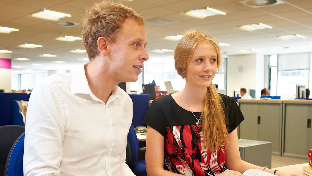 Two students on work placement in office