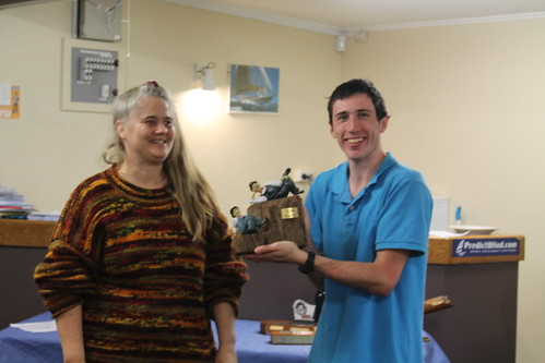 Chantal Grass presenting Andrew Coffin the Mad Hatter Trophy | by PLSC (Panmure Lagoon Sailing Club)