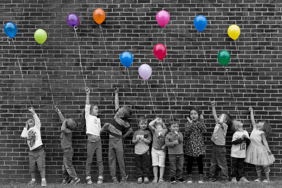 Kids With Balloons A Group Of Kids Holding Balloons One