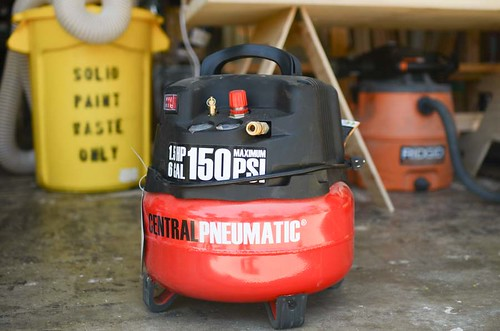 harbor freight's red/black air compressor in a wood shop | by yourbestdigs