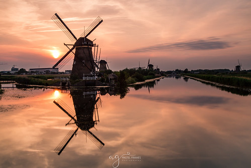 kinderdijk holland netherlands water reflections sunset clouds sky canon5dmark3 canon1635mm travel travelphotography photography landscape landscapephotography sun