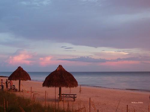 sunset lowdermilk naples beach gulf water tiki