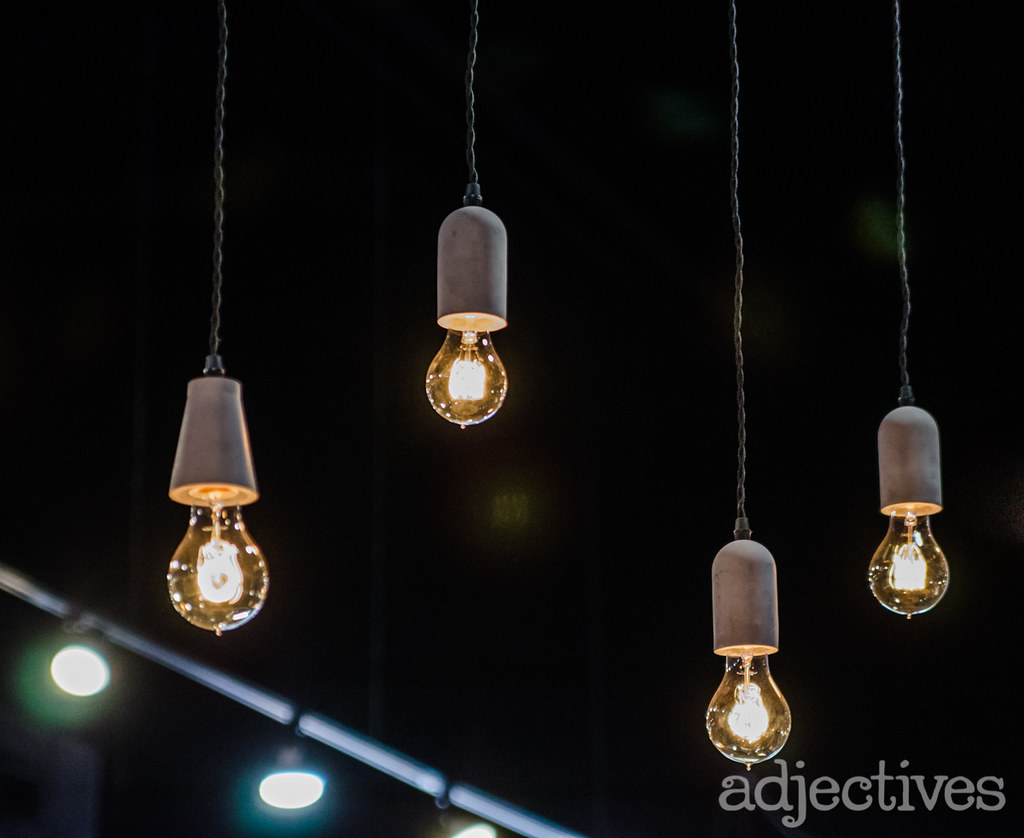 Concrete light fixtures and vintage inspired bulbs by Adjectives Altamonte