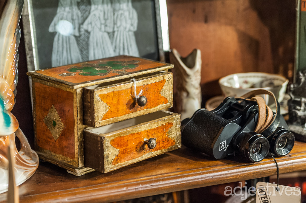 Vintage wood jewelry box and vintage binoculars by Daniel Boone at Adjectives Altamonte