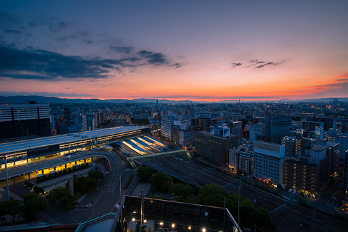 osaka japan skyline city cityscape sunrise twilight summer building mountain train modern