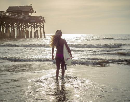 brevardlife cocoabeach sunrise surfing beach girl golden longboard model pier chuckpalmer outdoor travel sports