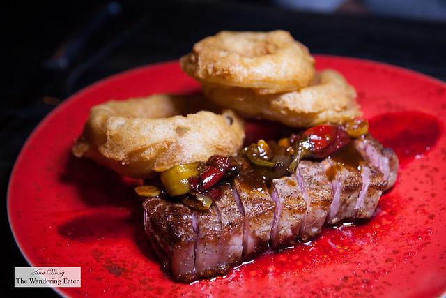 Scarlet Pepper Steak - chargrilled striploin, sweet & sour peppers, vidalia onion rings