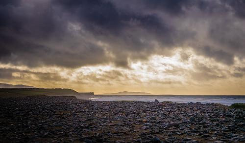 sun beach ocean ireland water clouds coast evening dusk comayo irl landscape scenic sunset dark coastline shore sunlight