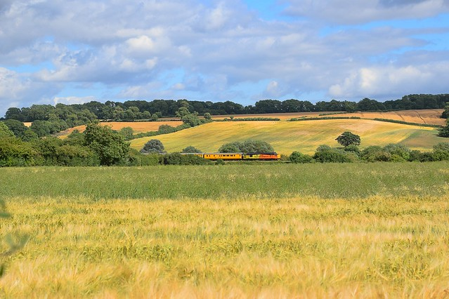 Passing by fields of ripening Barley, Colas 37175 propels a Network Rail Test Train from Derby RTC to Peterborough, with a DBSO leading, at Ketton. 14 07 2017
