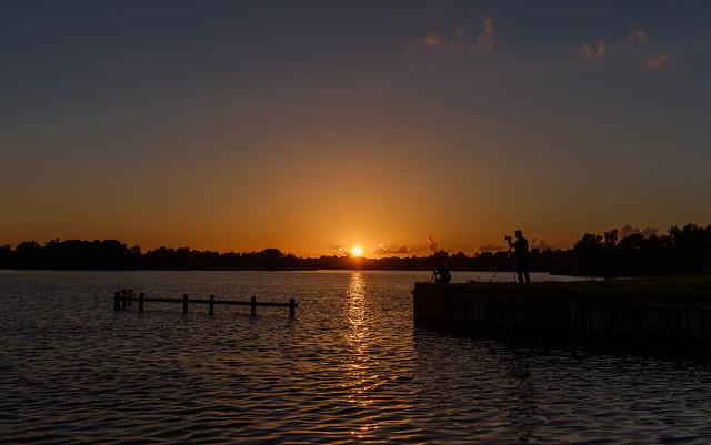 Photographers capturing a sunset