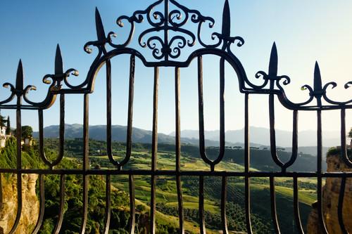 ronda andalucía spain es fence landscape lattice mountain plant repetition rock sunset town tree village