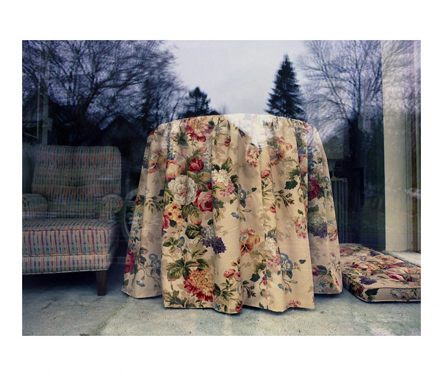 Floral fabric covering a table in a shop window