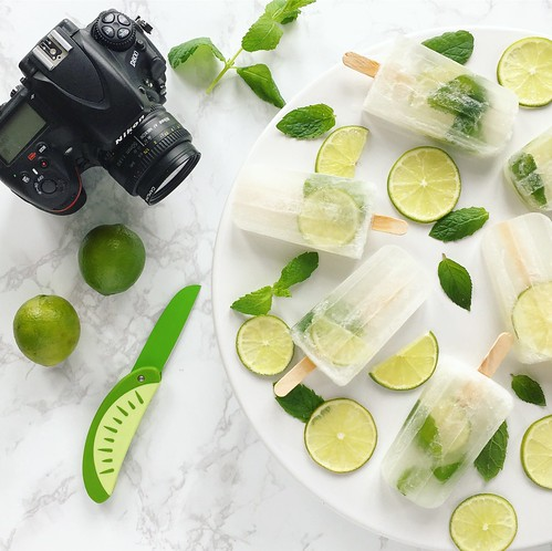 """Videoing myself clinking cocktail lollies together. Can't stop saying """"clink"""" every time 😆#recipevideo #foodphotography #mojito #cocktail #lollies #lollipops #popsicles #summer #clink 