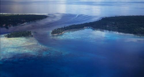 Entrance to the lagoon of Rangiroa Atoll in the Tuamotu Archipelago of French Polynesia. | by Derek Keats