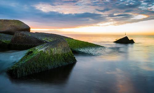baltic sea riga latvia lv rocks blue golden hour sunset landscape