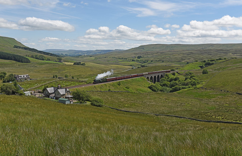 60103, Flying Scotsman makes a spirited climb to Ais Gill at Lunds with The Waverley 0n the 16th July 2017.  Although I think this shot is better in the winter months and is less greener, the views from up there looking back towards Wensleydale are stunning. We were a touch lucky as although it was predominantly blue skies the odd cloud and vapour trail did threaten to spoil the scene, luckily they didn't. It was good to chat to Simon Lathlane, Shep Wooley and John Hunt while up there waiting, all part of the enjoyment.