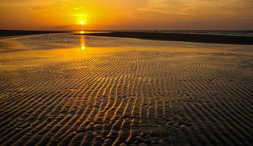 tidepool sunrise sun beach sand waves southcarolina seabrookisland
