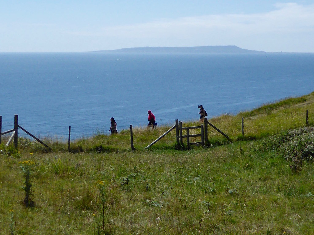 Walkers with the Isle of Portland beyond