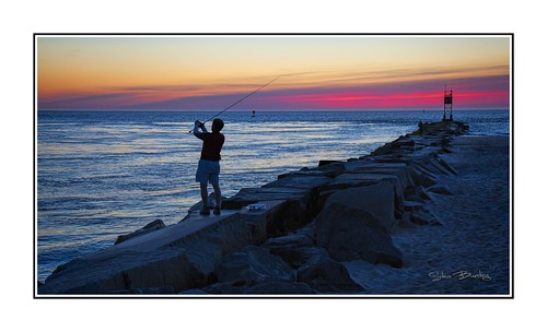 sunrise indianriverinlet fisherman sun water ocean atlanticocean