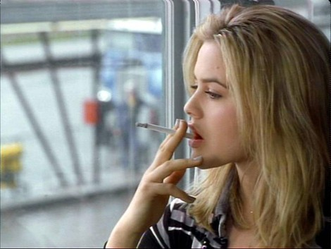 Alicia Silverstone smoking a cigarette (or weed)